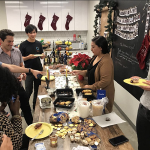 Employees celebrating with food