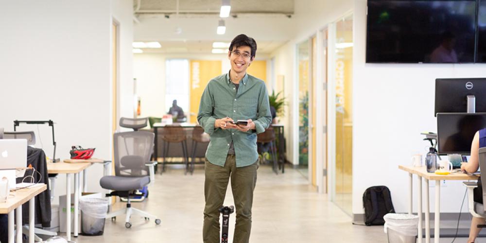 An employee standing in an office